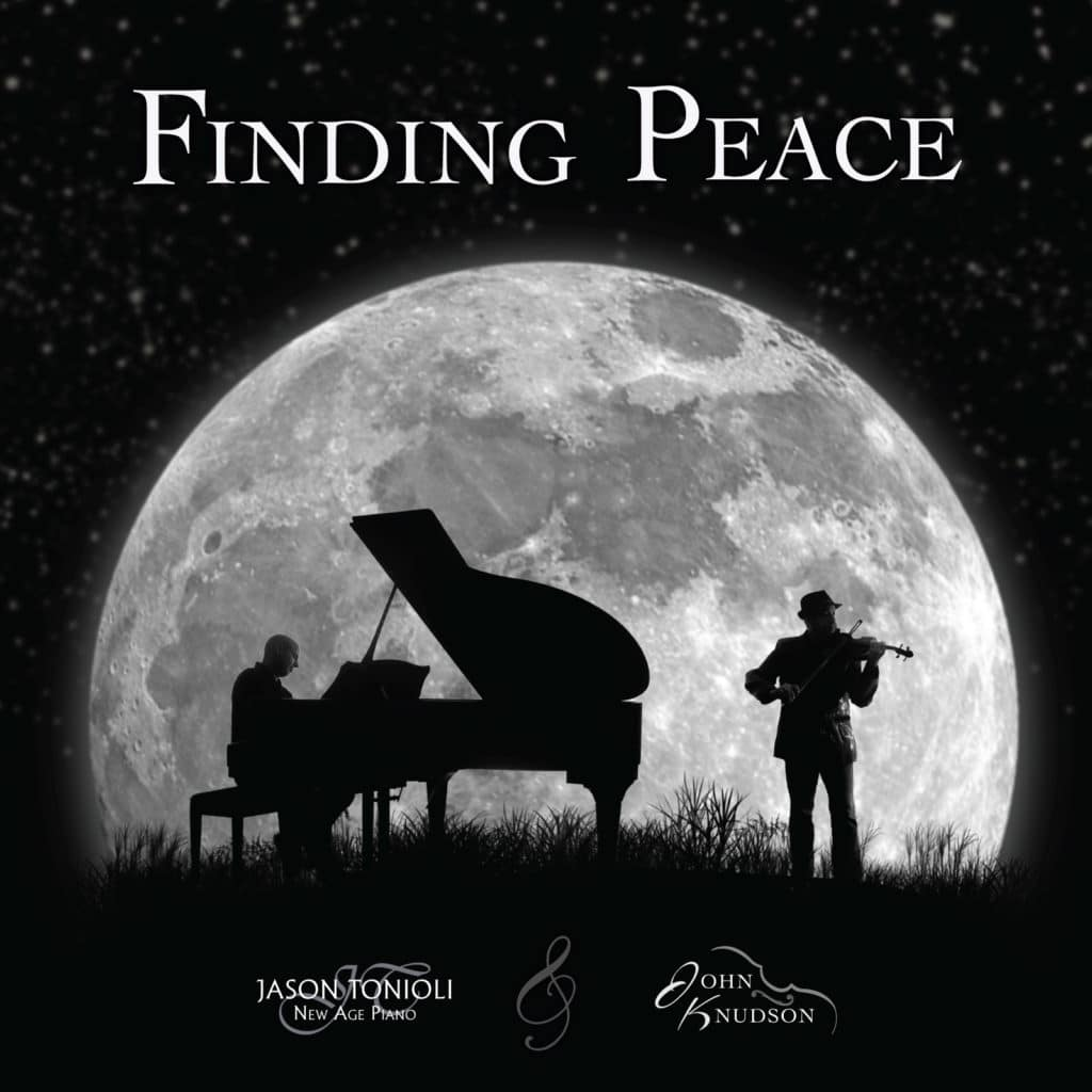Piano and Violin Sillouette behind moon